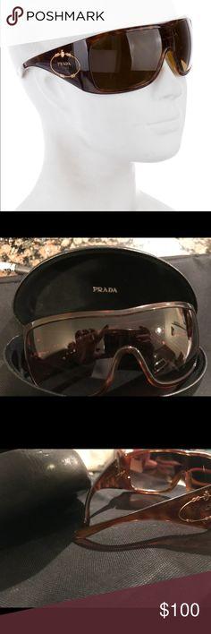 Prada Shield Sunglasses DISCONTINUED  Gorgeous pair of Prada sunglasses Case included Tortoise shell print with Gold Prada emblem on size  Oversized and super chic Prada Accessories Sunglasses
