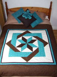 I like this....just on big block  http://perfectly4med.co.uk/2012/04/29/quilt-no-4-puzzle/#