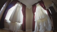This bride was lucky enough to have her mother's dress to display with hers...a unique and sentimental shot!!
