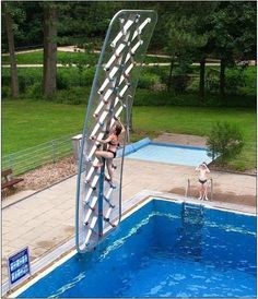 climbing wall by the pool.  how very cool!