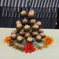 Cupcake~ Every wedding needs a cupcake tree so that everyone can head to the reception and go ahead and start eating while the Bride & Groom are having pictures taken so that when they arrive they can be announced and cut the actual wedding cake and then sit down to eat. (and everyone else can then get a piece of wedding cake)  this will help eliminate down time and help things run more smoothly during the reception. Simple Wedding On A Budget, Simple Weddings, Budget Wedding, Cupcake Tree, Bride Groom, Wedding Cakes, Reception, Eat, Pictures