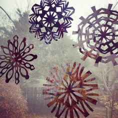 Upcycled paper snowflakes made from magazines! A fun snow day craft for kids!! Add some color to your winter pallor :)