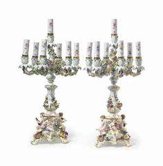 A PAIR OF MEISSEN PORCELAIN SEVEN LIGHT FLOWER-ENCRUSTED CANDELABRA--late 19th century