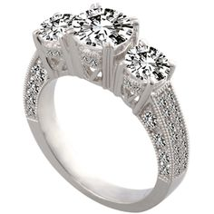 Three-Stone Micro-Pave Engagement Ring by http://www.engagediamonds.com/