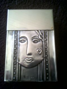 woman's face, pewter