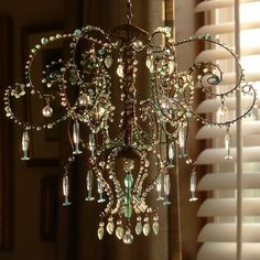 A Torquoise and Teal Sunshower Chandelier by BellStudios on Etsy