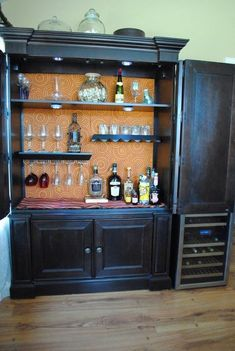 I could make my armoire into a coffee bar! Armoire Turned Bar Storage-lights, shelves with wine glass holders, wallpaper Armoire Bar, Armoire Antique, Old Entertainment Centers, Entertainment Center Furniture, Entertainment Stand, Furniture Projects, Furniture Makeover, Diy Furniture, Armoire Makeover