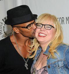 Shemar Moore plants a kiss on Kirsten Vangsness