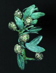JAR olive branch brooch in green sapphires, chrysoberyls and tourmalines; bronze-patina silver and gold. 2002 by JAR Paris.  source:  http://forum.purseblog.com/the-jewelry-box/jar-jewelry-635731-6.html