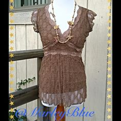 Dainty Tan Short Sleeved Lace TopListing Size small lace top by 6 Degrees. Color is a light brown...slightly deeper than tan . Has lining underneath. Has a sexy neckline. Worn only a couple of times. 6 Degrees Tops