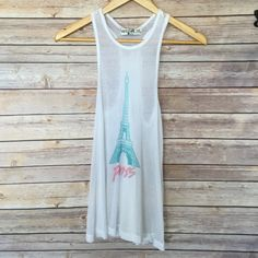 """Wild fox White Ribbed """"Paris"""" Tank White razor back ribbed tank top by Wildfox. Blue Eiffel Tower pictures in front with pink """"Paris"""" below. Eiffel Tower Pictures, Pink Paris, Sheer Fabrics, Wildfox, Fashion Tips, Fashion Design, Fashion Trends, Tank Tops, Stuff To Buy"""