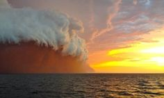 daunting.       Storm on Jan. 9, 2013 delivers Onslow, Australia a red-dust sunset - The West Australian.   Mother Nature put on a spectacular display ...where a menacing-looking storm was captured on camera by a tug boat worker.