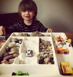Use drawer organizers for construction sensory play. Avoid the smaller stones for children who still mouth items - Image from Today's Parent Magazine Sensory Tubs, Sensory Activities, Sensory Play, Preschool Activities, Preschool Centers, Deco Kids, Todays Parent, Small World Play, Indoor Play