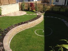 A newly constructed landscaped garden near Glasgow in Scotland with a spiral in the lawn.