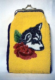 Native American beadwork by Lynnette Duenas. Beaded purse with husky and rose design in UW colors made in the 1980's.