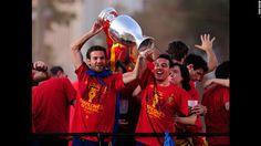Juan Mata, left, and Santi Cazorla of Spain hoist the Euro 2012 trophy