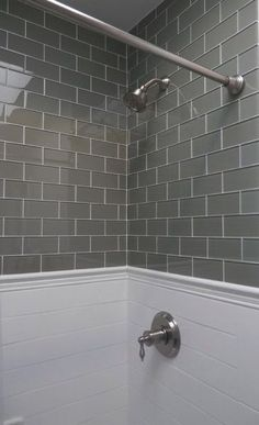 Gray glass subway tile paired with traditional white subways below.