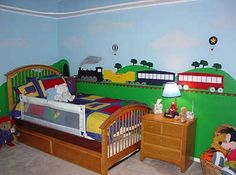Train themed bedroom for a toddler. Love the train mural, though its cartoonish and not to my tastes (I'd prefer it to be characters or look like a real life train). Great for a little boy.