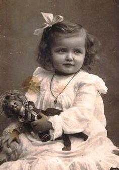 old vintage photo of girl with baby doll