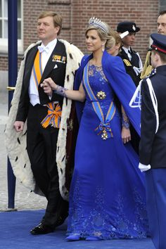 Maxima in the sapphires and matching blue gown and cloak
