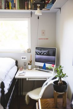 Small Space solution: A custom desk fits perfectly in the corner of this small bedroom. See the rest on the west elm blog!