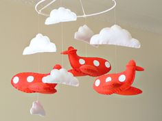 Musical airplane mobile - Tomato red felt airplanes and white clouds - Nursery Children Decor - Custom made to match your decor. $135.00, via Etsy.