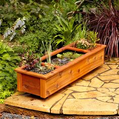 This patio pond in a wooden container holds both water plants and regular plants. With a paint-on rubber lining that's ultra-stretchy and UV resistant, it'll last years with little maintenance. Get the full details on how to build this patio garden pond planter here.