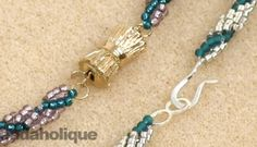 How to Add a Clasp to a Spiral Rope - Video. While this works,  I'd rather string the core beads on.014 Softflex, add the spiral loops, then use a crimp which supports a pendant or central bead more effectively.  #Seed #Bead #Tutorial