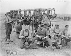 Royal Artillery drivers cleaning up their harness near Henin, 7 May 1917.
