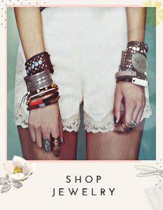 Bracelets and scalloped shorts