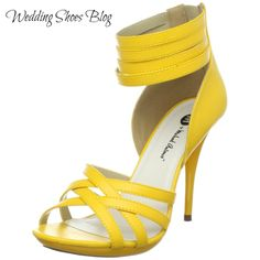 Modern Yellow Wedding Shoes are Fit for any Fashionista; When it comes to a trendy bride, she needs a dress and a pair of shoes that echo those sentiments. http://www.weddingshoesblog.com/modern-yellow-wedding-shoes-are-fit-for-any-fashionista/ #wedding #style #fashion #shoes