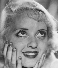 Bette Davis....love her freckles, nail polish, everything!