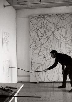 Brice Marden  I think this a grid picture because of how the lines of the walls would line up, and because of where the man is placed in the picture.