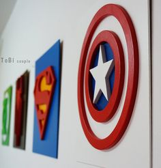 Superhero Captain America  This cool Wall hanging superheroes is ideal for decor in children room. Choose favorite superhero to your child.  Ready to hang. Made from plywood and MDF.  Measures 30 cm x 30 cm (12 x 12). We use silky matt paint on water based. Ready to hang on the wall.  On the amount over $ 200 (not included shipping) you get a one additional superhero (send me note which additional superhero you want).  See more Superheroes: www.etsy.com/shop/HeroesCreations