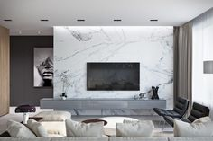 Marble isn't just for floors anymore. This slab-style wall brings this livin… Marble isn't just for floors anymore. This slab-style wall brings this living room from simple to spectacular. Feature Wall Living Room, Living Room Modern, Living Room Interior, Home Living Room, Home Interior Design, Living Room Decor, Tv Feature Wall, Wall Cabinets Living Room, Design Interiors