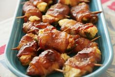 Jalapenos stuffed with cream cheese and brown sugar wrapped in bacon sprinkled with salt, pepper, and more brown sugar. YUM!