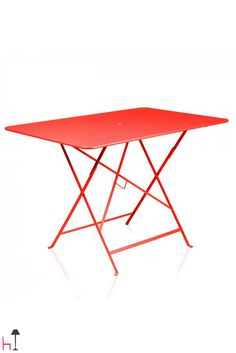 Spacious, lightweight and easy to carry, the Bistro folding table by Fermob is designed to help you make the most of your happy times spent outdoors.