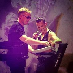 Dave Gahan messing with Andy Fletcher on stage with Depeche Mode