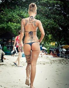 {Love the bow lace up on the back of her leg!!} #hottieswithtattoos #tattoos #womenwithtattoos