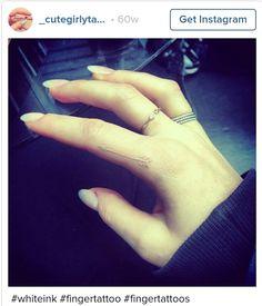 White finger tattoo