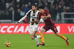Andrea Barzagli (L) of Juventus FC competes with Diego Perotti of AS Roma during the Serie A match between Juventus FC and AS Roma at Juventus Stadium on December 17, 2016 in Turin, Italy.