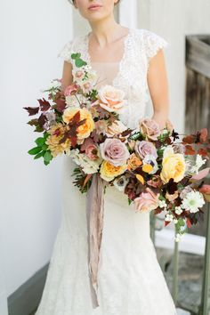 Anemone, dahlia and rose fall hued wedding bouquet: Photography : Corina V. Photography Read More on SMP: http://www.stylemepretty.com/canada-weddings/ontario/cambridge-ontario/2017/03/23/moody-fall-wedding-inspiration/
