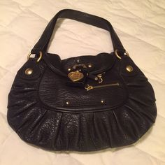 AUTHENTIC JUICY COUTURE black leather Handbag. This is a really nice mid size purse that would be perfect for your teen or even you if you like a smaller bag. It comes with a pink dust bag. Lining is clean. Non smoking home. Juicy Couture Bags