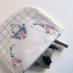 Laminated pouch from antique pillowcases or  hankies, with liner fabric and zipper to make a cute make up or lingerie bag ~ http://thehabygoddess.blogspot.com.au/2012/05/tutorial-laminated-doily-zip-purse.html