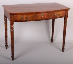 OnlineGalleries.com - Early 19th century mahogany bow-fronted side-table