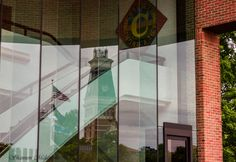 Bartholomew County Courthouse reflected through City Hall in Columbus, Indiana. Photo by Shannon Malanoski