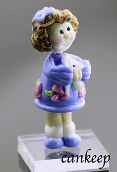 Goldilocks with her Bunny. Glass bead sculpture by Lezlie Belanger