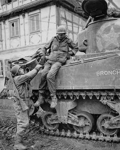 PFC Ray F. Lohof, 'B' Company, Armored Infantry Battalion, Armored Division being helped off a tank after the battle of Ober-Otterbach, 18 December Ww2 History, Military History, Sherman Tank, Military Armor, Military Pictures, War Photography, Ww2 Tanks, Battle Tank, Vietnam War