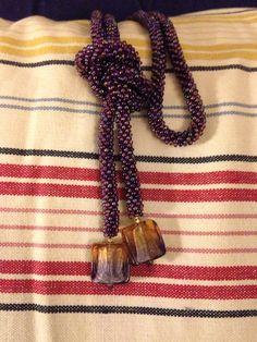 I made... Purple iris sb11, 4bd round, 110cm rope, square purple gold chromatic glass focal beads