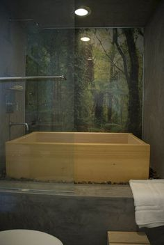 wooden bath tub, plus the great faucet